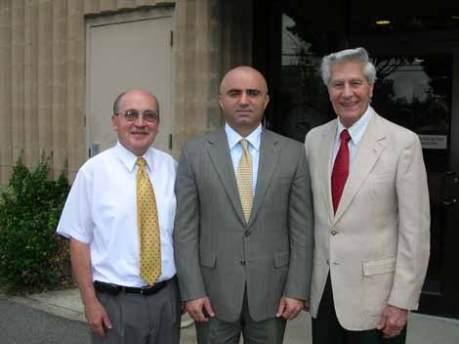 Ambassador Armen Martirosyan, center, with AMAA executive director Andy Torigian, right, and field director Dikran Youmshakian.
