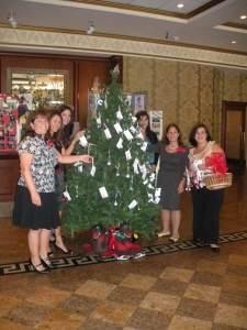 Decorating the Christmas Tree with Donation Card Ornaments